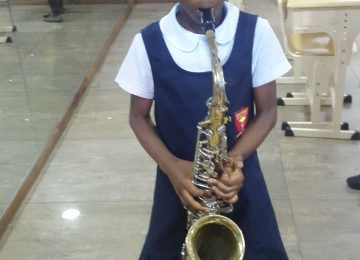 PLAYING TENOR SAX